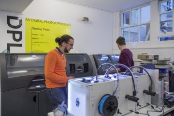 Students in the digital prototyping lab using laser-cutting machines, 3D printers and CNC machines. There is also a workshop for wood, metal and casting.  Image credit: Valerie Bennett
