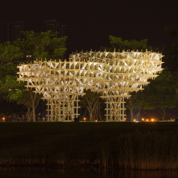 The pavilion mimics the splendour and rarity of identical triplets in the form of three random trees.